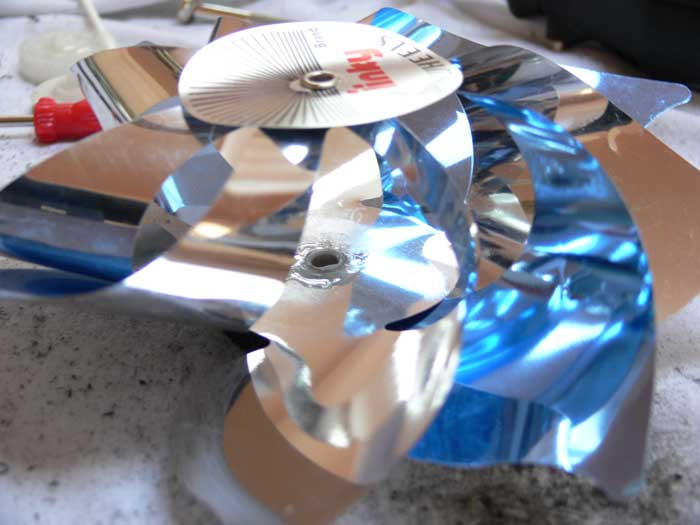 Pinwheel fan with a mass of epoxy spread around the center of the plastic cylindrical piece of the main gear
