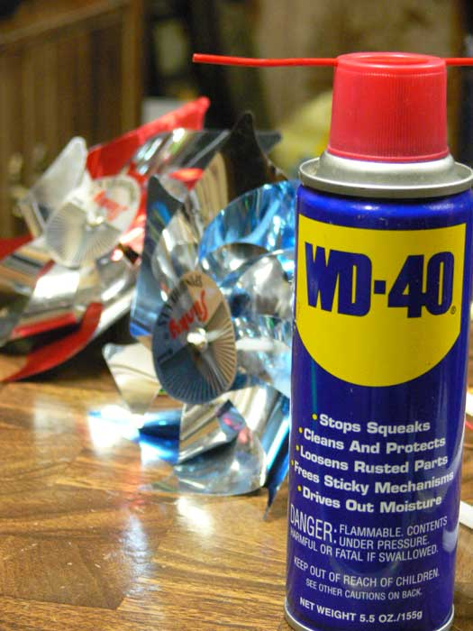WD-40 on the right with sparkling LED pinwheels trailing off to the left