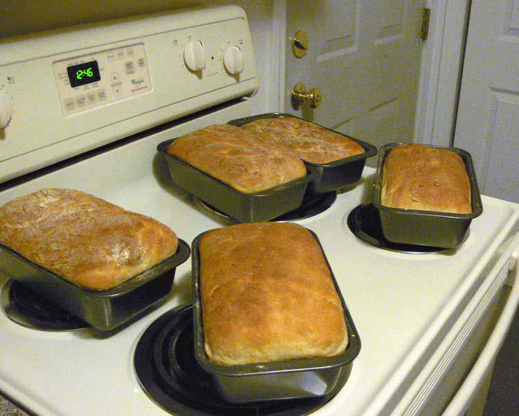 Bread cooling on the top of an electric stove.