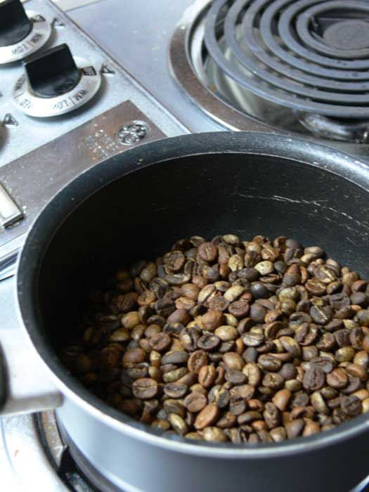 Coffee beans niceley roasted in a pan on the stove